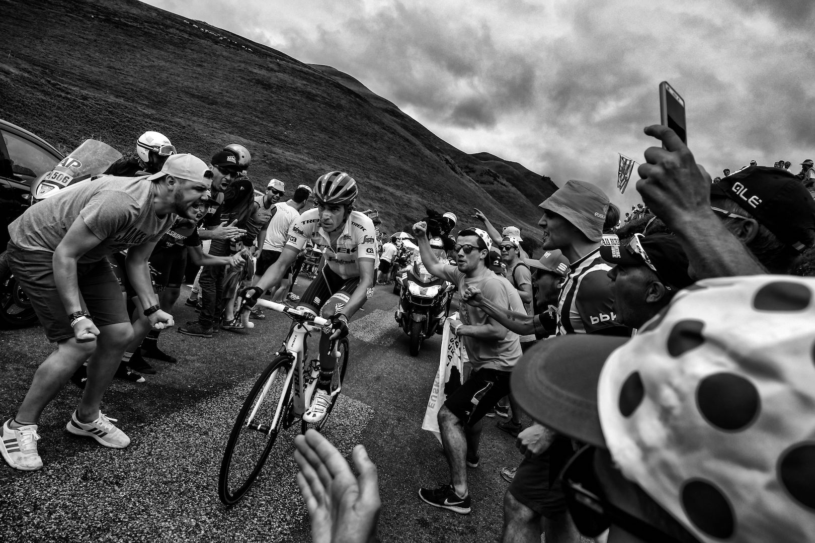 BLACK AND WHITE VERSION Spain's Alberto Contador rides in a breakaway as supporters cheer during the 214,5 km twelfth stage of the 104th edition of the Tour de France cycling race on July 13, 2017 between Pau and Peyragudes. / AFP PHOTO / JEFF PACHOUD (Photo credit should read JEFF PACHOUD/AFP/Getty Images)
