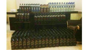 Bottles of whisky and vodka seized by Haia authorities and police from an apartment in Jeddah are shown in this picture, courtesy of sabq.org.