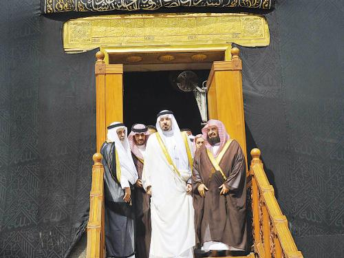 Makkah Emir Prince Mishal Bin Abdullah and other dignitaries come out of Kaaba after the ceremonial washing ceremony on Thursday.