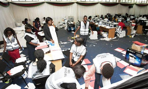 Malawi Electoral Commission workers continue to work out the results of Malawiís, in this May 20, 2014 photo, Tripatite Elections at the National Tally Centre in Blantyre on May 28, 2014.