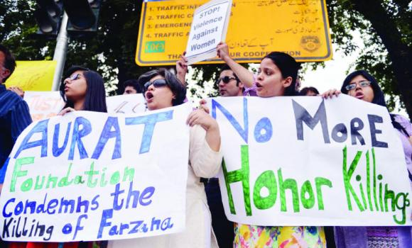 Human rights activists hold placards during a protest in Islamabad on Thursday against the killing of a woman by members of her family for marrying a man of her own choice in Lahore.