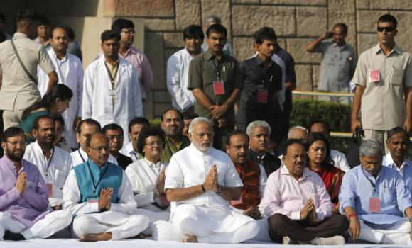 Narendra Modi prays at Rajghat, the memorial of Mahatma Gandhi, in New Delhi.
