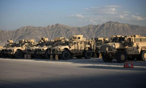 Mine resistant armored vehicles and other machinery waiting to be transported out of Afghanistan are seen on the flight line at Bagram Airfield in Parwan on Wednesdat. US forces will complete their withdrawal from Afghanistan by the end of 2016, President Barack Obama has said, unveiling a plan to end America's longest war. (AFP Photo/Brendan Smialowski)