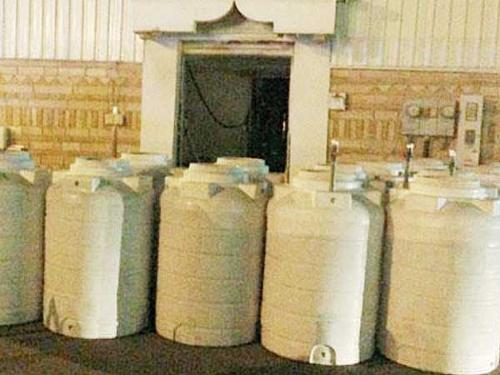 Liquor barrels found inside a house raided by members of the Commission for the Promotion of Virtue and Prevention of Vice in Hofouf, Al-Ahsa