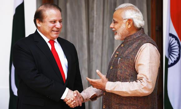 Indian Prime Minister Narendra Modi, right, shakes hand with his Pakistani counterpart Nawaz Sharif before the start of their meeting in New Delhi on Tuesday. (AP Photo/Saurabh Das)