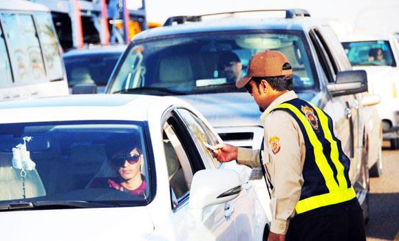 A traffic security officer in Yanbu checks the vehicles.