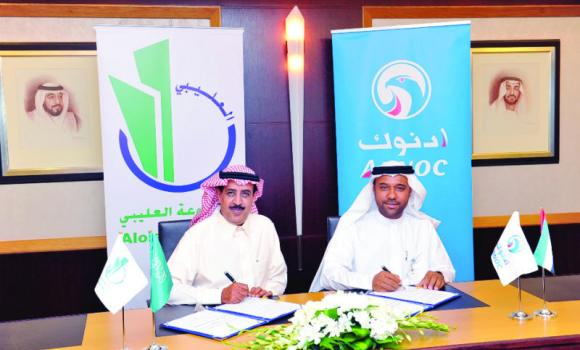 Abdulla Salem Al-Dhaheri, chairman of ADNOC Distribution Global Company, and Eid Abdul Hadi Al-Olalibi, GM, Al-Olalibi Service Station Operation and Management Company, at the signing ceremony.