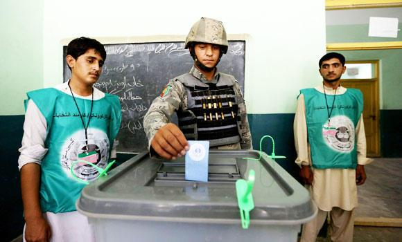 An Afghan policeman casts his vote at a polling station in Jalalabad, east of Kabul, Afghanistan, on Saturday.