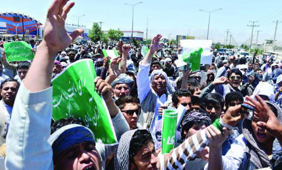 Afghan demonstrators shout slogans in support of presidential candidate Abdullah Abdullah in Kabul on Saturday.