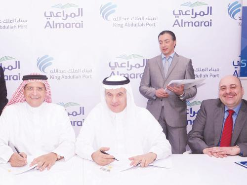 Abdullah Hameedaddin, Managing Director of PDC and Eng. Abdulrahman Al Fadley, CEO of Almarai sign the agreement in the presence Fahd Al-Rasheed, CEO of King Abdullah Economic City, alongside a number of representatives from both sides.