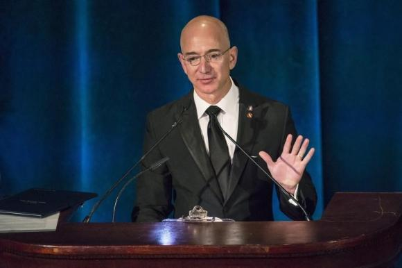 Amazon CEO and Chairman Jeff Bezos receives the Citation of Merit on behalf of the Apollo F-1 Search and Recovery Team during the 110th Explorers Club Annual Dinner, at the Waldorf Astoria in New York March 15, 2014.