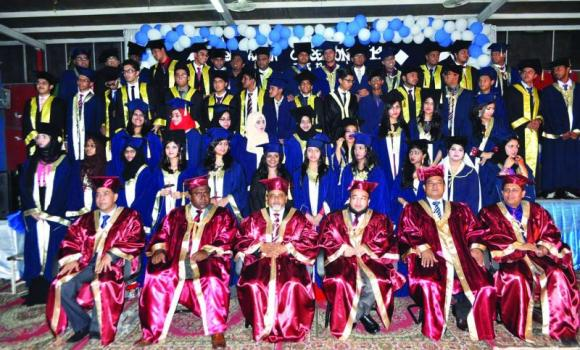 Students of Bangladesh International School-Jeddah pose for a group picture with guests and teachers at the graduation ceremony.
