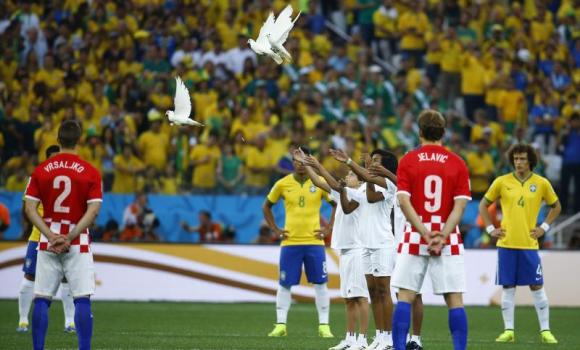 Doves fly after being released before the start of the 2014 World Cup opening match between Brazil and Croatia at the Corinthians arena in Sao Paulo on Thursday.