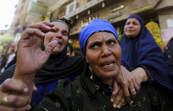 Relatives and families of members of the Muslim Brotherhood and supporters of ousted Egyptian President Mohamed Mursi react outside a court in Minya, south of Cairo, after the sentences of Muslim Brotherhood leader Mohamed Badie and his supporters were announced