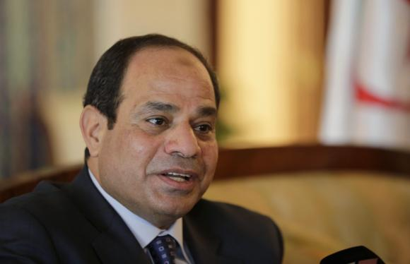 Egypt's President Abdel Fattah al-Sisi answers a question upon his arrival at Algiers airport.