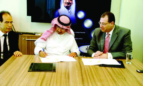 Faisal Al-Mubarak, the provost and chief academic officer of Alfaisal University, left, at the signing ceremony.