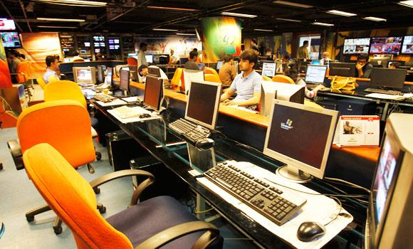 People work in a control room of the GEO News television in Karachi, Pakistan, on Friday. (AP)