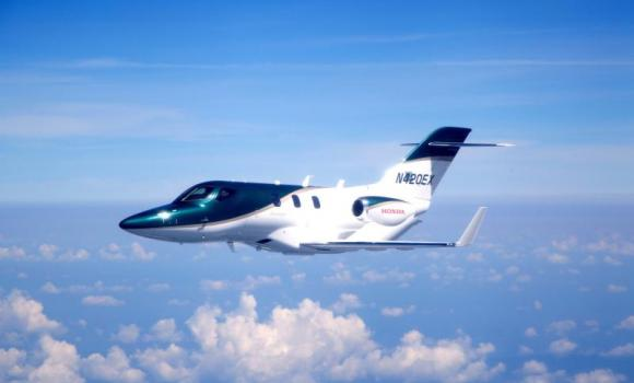 This handout picture shows Honda Motor's aviation subsidiary Honda Aircraft's first production HondaJet during a test flight at Greensboro, US.