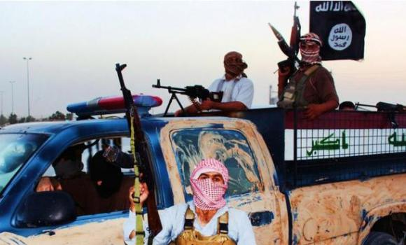 An image uploaded on June 14, 2014 on the jihadist website Welayat Salahuddin shows militants of the Islamic State of Iraq and the Levant (ISIL) riding in a captured vehicle left behind by Iraqi security forces at an unknown location in the Salaheddin province.