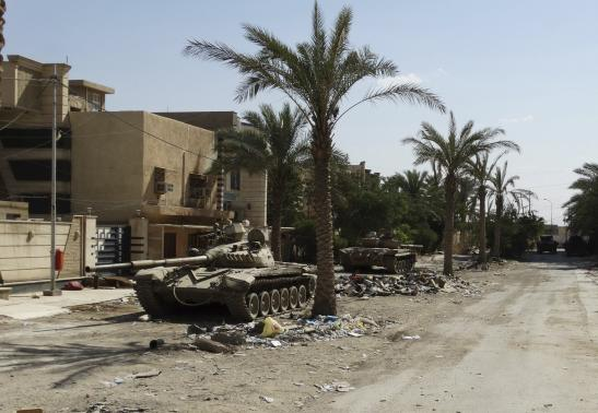 Tanks belonging to Iraqi security forces are seen during clashes with the al Qaeda-linked Islamic State of Iraq and the Levant (ISIL) in the city of Ramadi June 19, 2014.