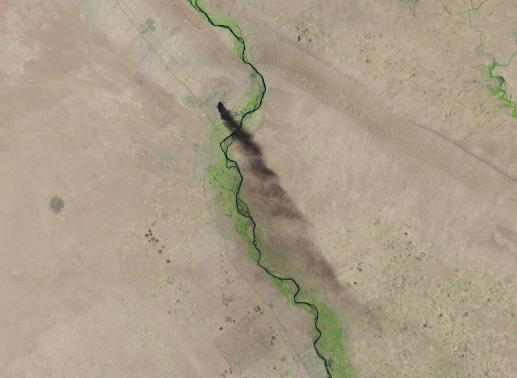 A U.S. Geological Survey satellite image shows smoke rising from the Baiji refinery near Tikrit, Iraq, June 18, 2014 in this handout provided by U.S. Geological Survey.