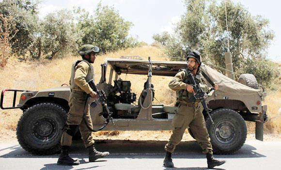 Israeli soldiers patrol near the West Bank city of Hebron on Friday.