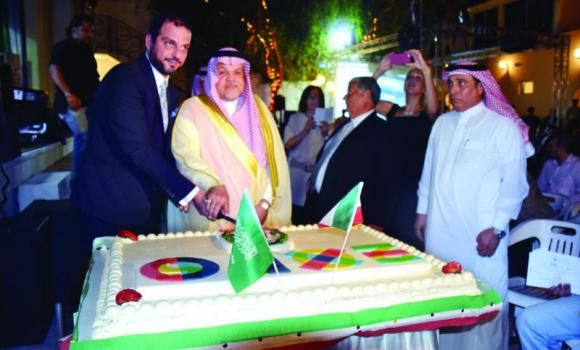 Italian Consul General Simone Petroni and Jamal B. Balkhoyoe of the Ministry of Foreign Affairs cut the cake to celebrate the 68th National Day of Italy in Jeddah.