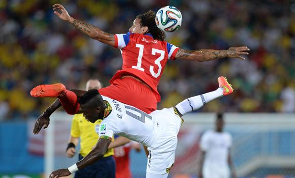 US midfielder Jermaine Jones (L) vies with Ghana's defender Daniel Opare (R) during a Group G football match between Ghana and US at the Dunas Arena in Natal during the 2014 FIFA World Cup on Monday.