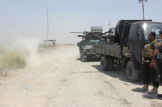 Iraqi security forces patrol after clashes with the predominantly Sunni militants from the radical Islamic State of Iraq and the Levant (ISIL) in the town of Dalli Abbas in Diyala province.