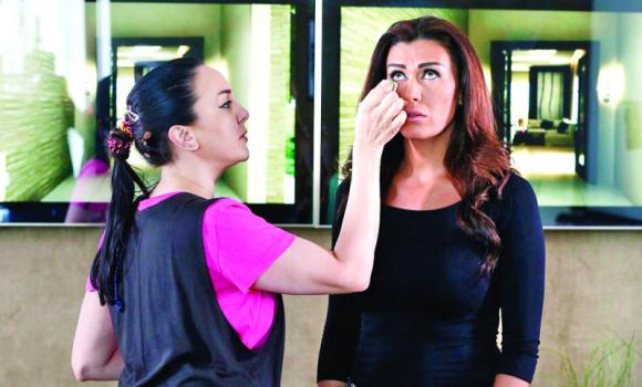 Lebanese actress Nadine el Rassi has her make-up touched up while shooting a show at Abu Dhabi's media hub Twofour54.