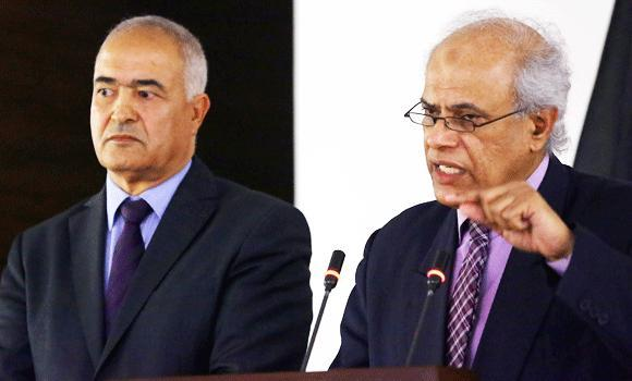 Libyan Justice Minister Salah al-Marghani (R) speaks next to foreign ministry spokesman Said Lassoued during a press conference on Wednesdayy in the capital Tripoli after US Special forces carried out a stealth operation in the country.