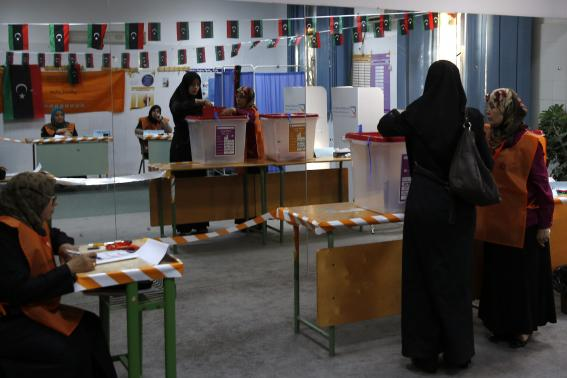 A woman votes at a polling station inside a school in Tripoli.