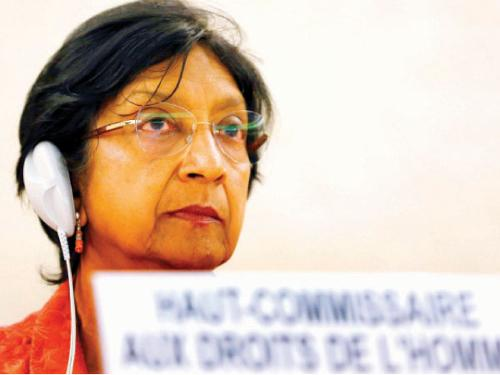 UN High Commissioner for Human Rights Navi Pillay looks on after her address to the 26th session of the Human Rights Council at the United Nations in Geneva Tuesday.