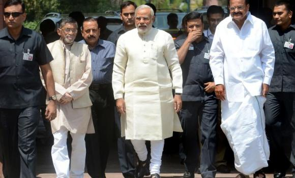 Indian Prime Minister Narendra Modi arrives with Parliamentary Affairs and Urban Development Minister Venkaiah Naidu for the first session of India's newly elected parliament in New Delhi. (AFP)