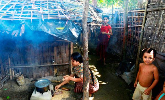 A Rohingya Muslim woman cooks a meal in Zedipyin village at Maungdaw, in the northern Rakhine state, in this June 6, 2014 photo.