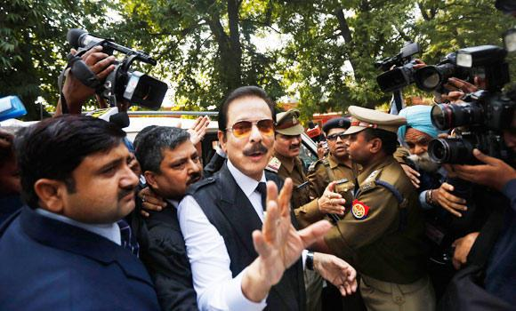 In this March 4, 2014 photo, head of Sahara India conglomerate Subrata Roy speaks to the media as he arrives at the Supreme Court for a hearing in New Delhi, India. (AP)