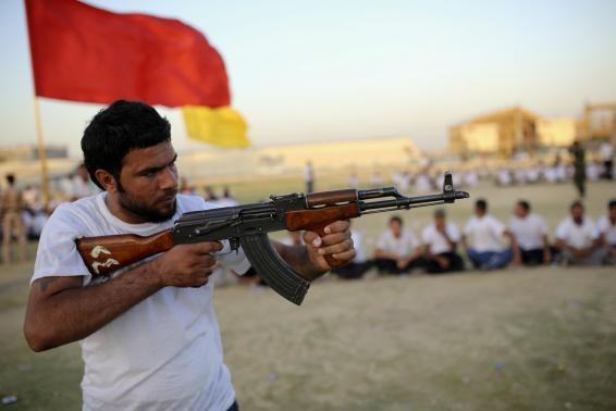 A Shi'ite volunteer from the Supreme Islamic Iraqi Council holds a gun during a training in Najaf.