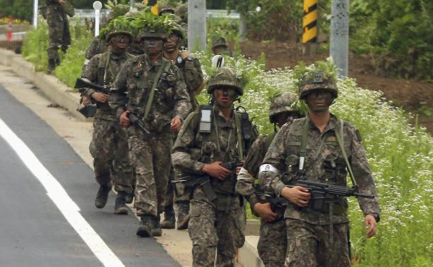 South Korean soldiers patrol during a search and arrest operation in Goseong.