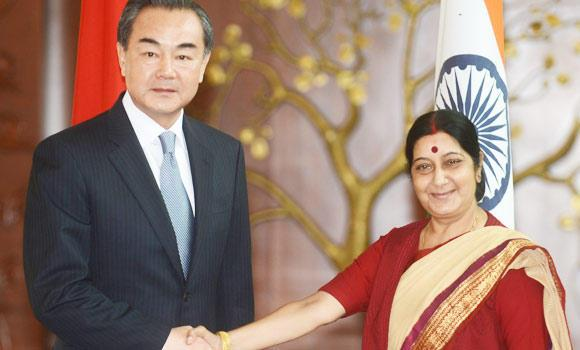 Visiting Chinese Foreign Affairs Minister Wang Yi (L) shakes hands with Indian Minister for External Affairs Sushma Swaraj during a meeting in New Delhi on Sunday. (AFP)
