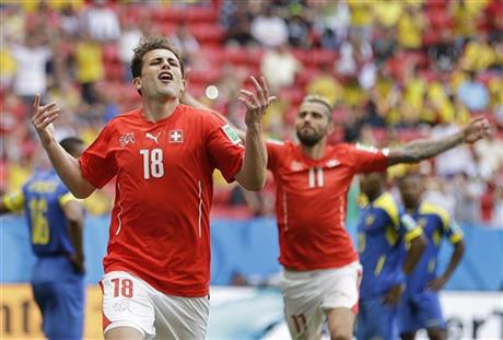 Switzerland's Admir Mehmedi celebrates after scoring his side's first goal during the group E World Cup soccer match between Switzerland and Ecuador at the Estadio Nacional in Brasilia, Brazil, Sunday, June 15, 2014.