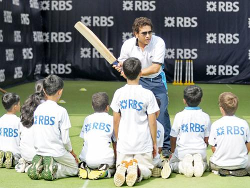 Retired Indian cricketing legend Sachin Tendulkar holds a training session for young players at the Singapore Cricket Club Tuesday.