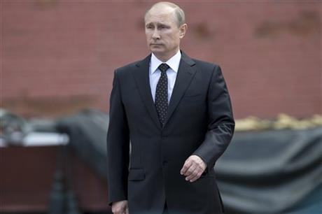In this photo taken on Sunday, June 22, 2014, Russian Vladimir Putin takes part in a wreath laying ceremony at the Tomb of the Unknown Soldier outside Moscow's Kremlin Wall, in Moscow, Russia, to mark the 73rd anniversary of the Nazi invasion of the Soviet Union. Russian news agencies say President Vladimir Putin has asked parliament to cancel a resolution that sanctions the use of military force in Ukraine. Putin wrote to the head of parliament's upper house asking that a March 1 request authorizing the use of force in neighboring Ukraine be withdrawn.