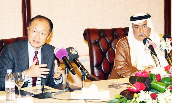 World Bank Group President Jim Yong Kim (L) gestures during a joint press conference alongside the Saudi Arabian Finance Minister Ibrahim Al-Assaf (R), after the end of their meeting in the Saudi coastal city of Jeddah on Sunday.