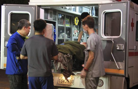 A wounded soldier is carried from an ambulance to a hospital in Gangneung