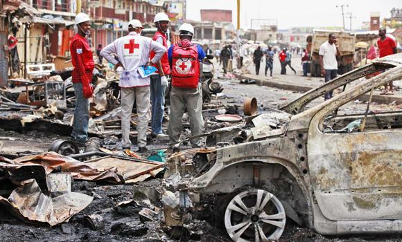 Red Cross personnel search for remains at the site of a Boko Haram car bomb attack in Jos, Nigeria, in this May 21, 2014, photo. Boko Haram militants are taking over villages in northeastern Nigeria, killing and terrorizing civilians and political leaders, witnesses say, as the self-proclaimed Islamic fighters make a comeback from a year-long military offensive aimed at crushing them. (AP)