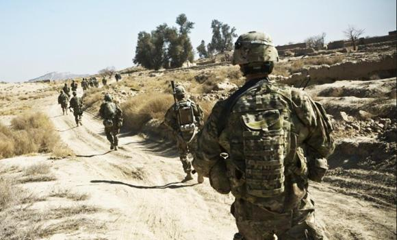 """British soldiers are shown on patrol in Afghanistan's Helmand province in this file photo. A UK Ministry of Defense report says thousands of British soldiers are overweight and """"too fat to fight."""""""