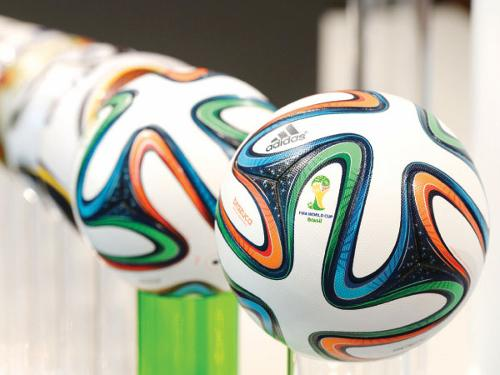"The Adidas official FIFA World Cup ball ""Brazuca"" are present beside former World Cup ball's during the company's shareholders' meeting in Fuerth, southern Germany."