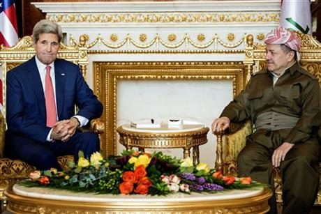Kurdish regional President Massoud Barzani, right, listens to U.S. Secretary of State John Kerry during a meeting at the presidential palace in Irbil, Iraq, Tuesday, June 24, 2014. Kerry arrived in Iraq's Kurdish region in a US diplomatic drive aimed at preventing the country from splitting apart in the face of militants pushing towards Baghdad.