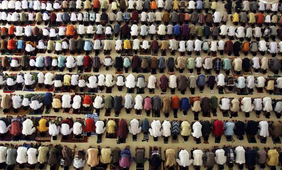 Students at an Islamic boarding school perform prayers at a mosque on the first day of the holy fasting month of Ramadan in Medan, North Sumatra, on Sunday.