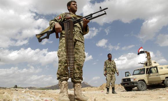 Army soldiers man a checkpoint in al-Mahfad, in the southern Yemeni province of Abyan, in this May 23, 2014, file photo. Yemeni forces have to contend with Al-Qaeda insurgents as well as Houthi Shitte rebels. (Reuters/Khaled Abdullah)